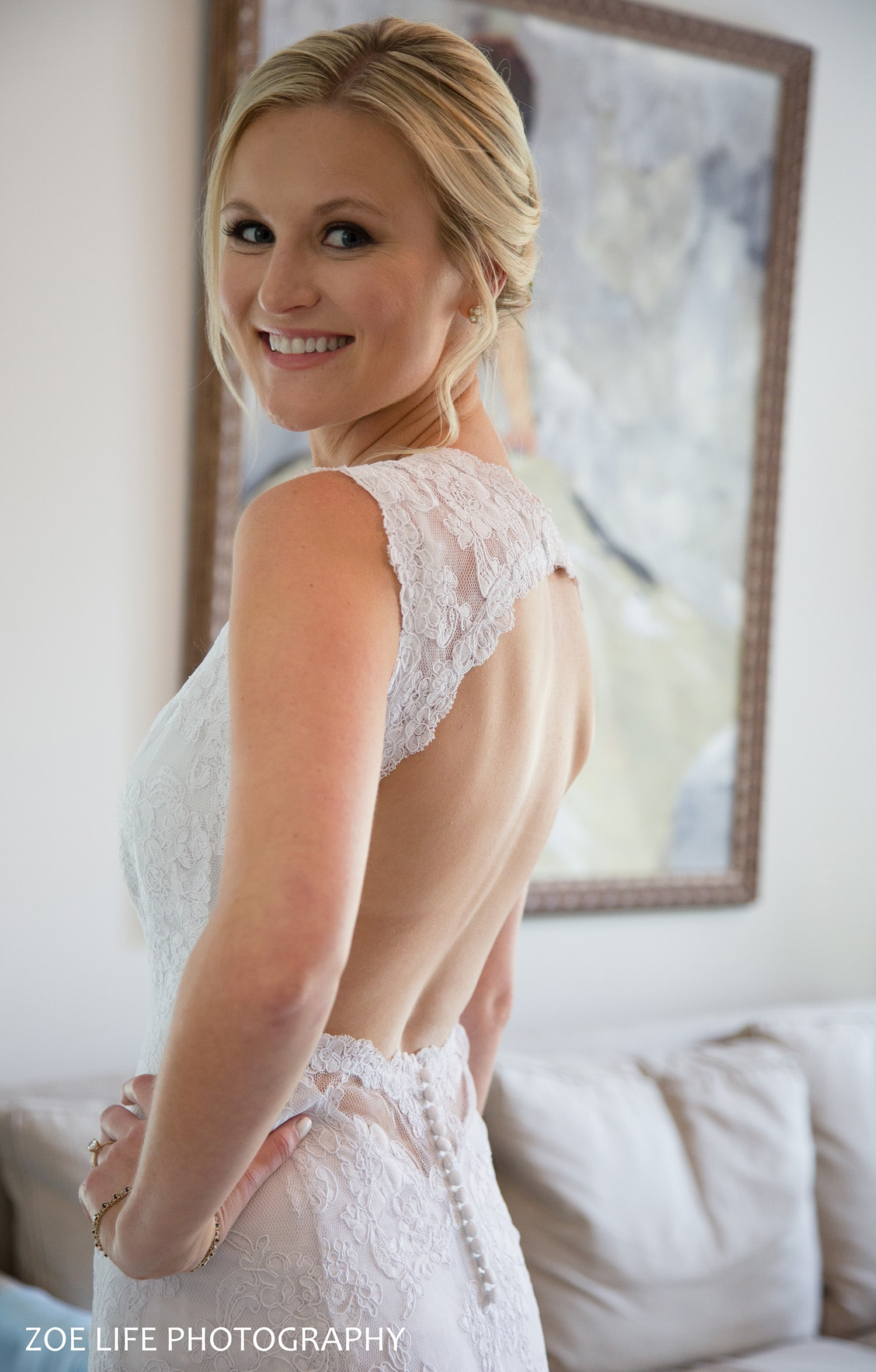 A gorgeous bride showing off her wedding dress
