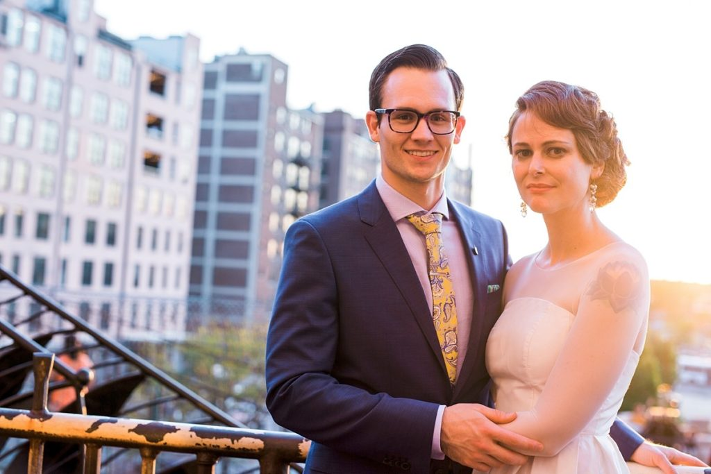 Sunset Portrait of Bride and Groom at top of City Museum