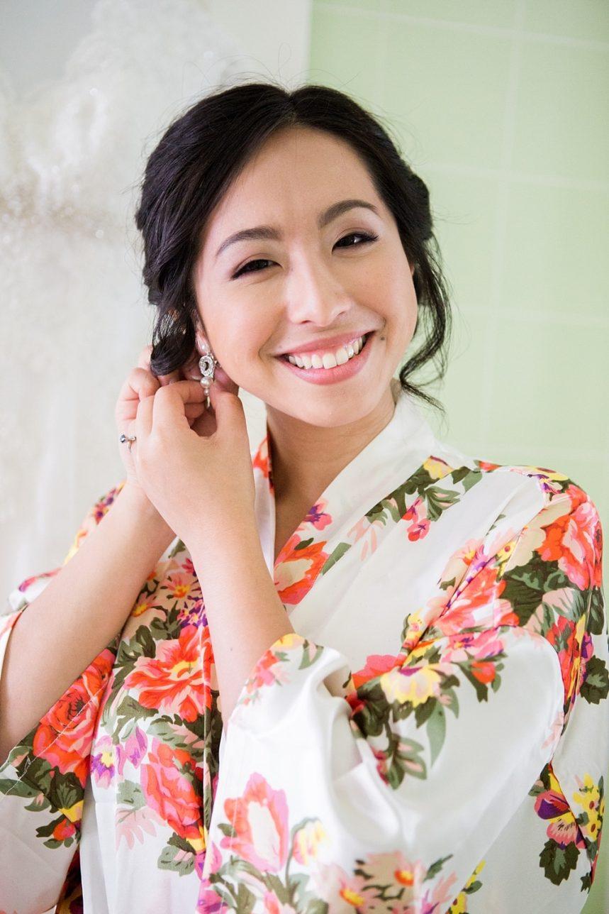 Bride Putting on Earrings in Her Robe