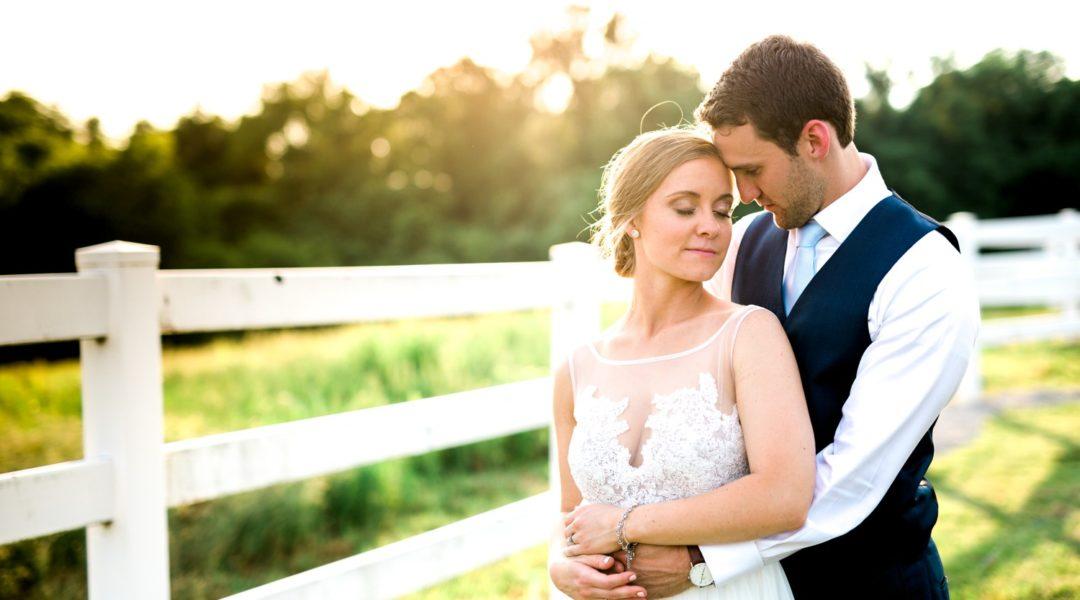 Sunlit Fence Bride and Groom Portrait