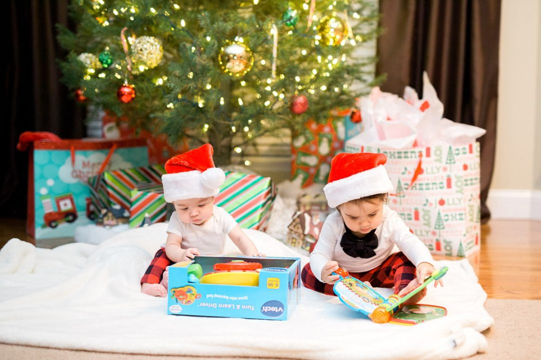 Baby and Toddler Sitting Under Christmas Tree with Red Christmas Hats, Holiday Photo Shoot, Christmas Lights Photography, St. Louis Family Photographer