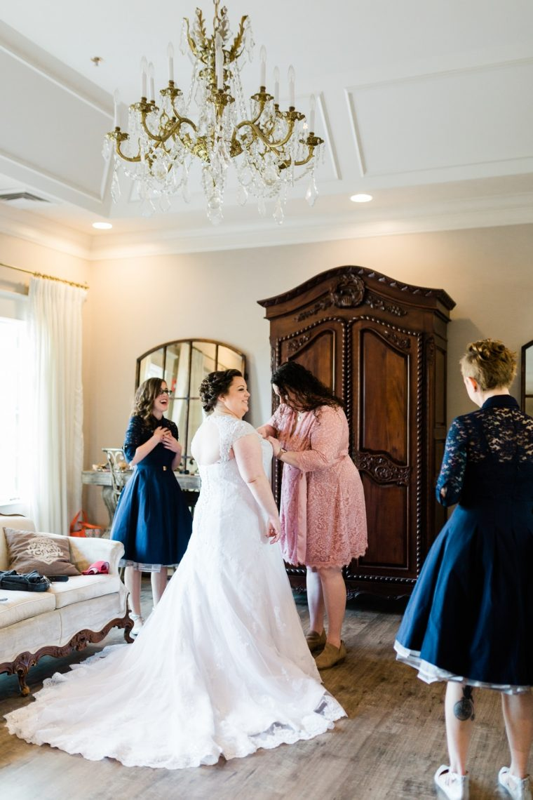 St. Louis Wedding Photographers, Silver Oaks Chateau Wedding, Bride getting into wedding dress