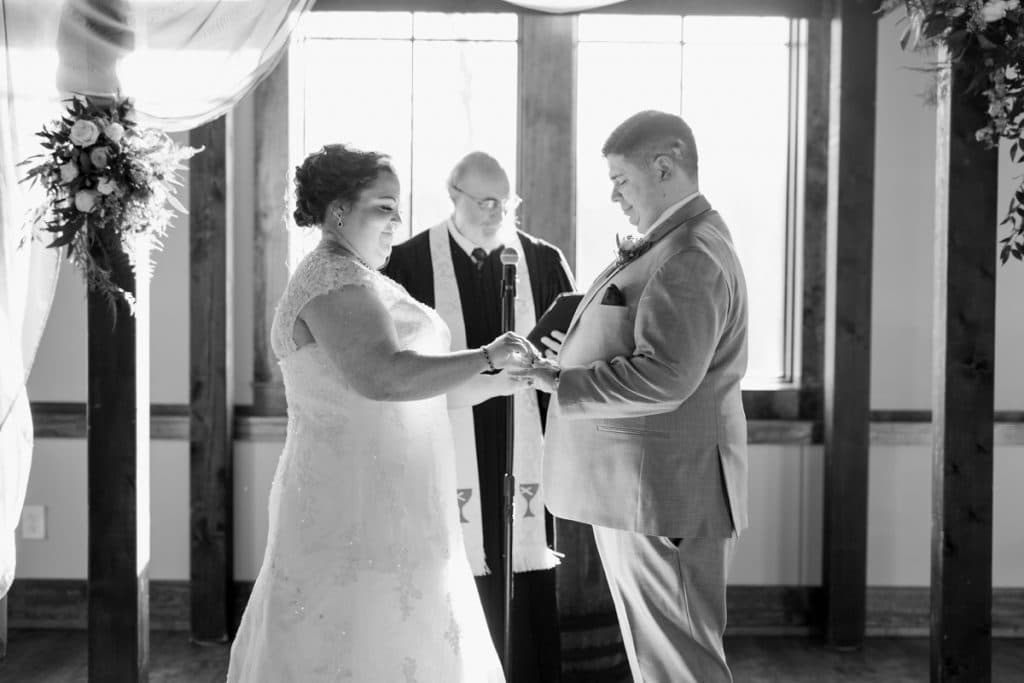 St. Louis Wedding Photographers, Silver Oaks Chateau Wedding, Bride and Groom Exchanging Rings